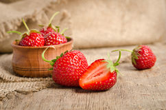 Ripe Strawberry in a wooden Bowl Royalty Free Stock Photography