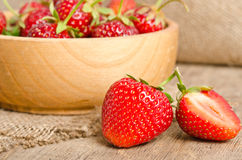 Ripe Strawberry in a wooden Bowl Stock Images