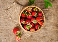 Ripe Strawberry in a wooden Bowl Stock Photos