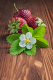 Ripe strawberry on wooden table Royalty Free Stock Photography