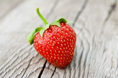 Ripe strawberry on wooden table Stock Photos
