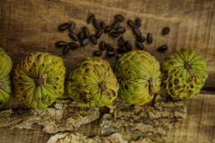Ripe Sugar-apple Seeds by Unbroken Fruits on Wooden Table Stock Photography