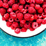 Ripe Summer Raspberry in a bowl over textuted colorful backgroun. D close up Stock Images