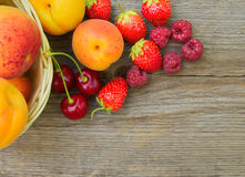 Ripe Sweet Berries and Fruits on the Wooden Table. Space for Text Royalty Free Stock Image
