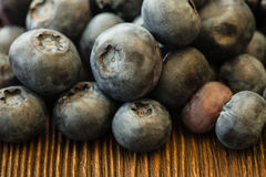 Ripe sweet blueberries on wooden table Stock Photos