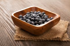 Ripe sweet blueberries on wooden table. Heap ripe sweet blueberries on wooden table top view Royalty Free Stock Photo
