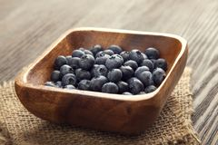 Ripe sweet blueberries on wooden table. Heap ripe sweet blueberries on wooden table top view Royalty Free Stock Photography