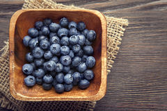 Ripe sweet blueberries on wooden table Royalty Free Stock Image