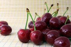 The Ripe sweet cherries. Ripe sweet cherries on bamboo small rug Royalty Free Stock Photo