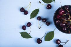Ripe sweet cherry in a black bowl royalty free stock photos