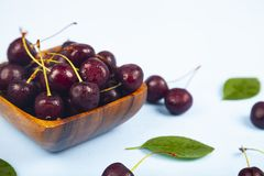 Ripe sweet cherry in a square bow stock images
