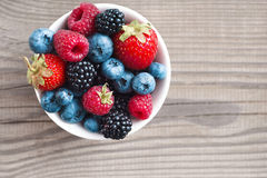 Ripe sweet different berries in bowl. Stock Image