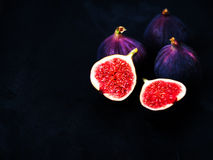 Ripe sweet figs on black background. Healthy Fresh fig fruit, vi Royalty Free Stock Photography