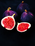 Ripe sweet figs on black background. Healthy Fresh fig fruit, vi Stock Photos