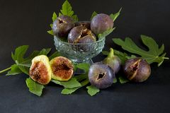 Ripe sweet figs with green leaves, mediterranean fig fruit. Royalty Free Stock Photography