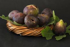 Ripe sweet figs with green leaves, mediterranean fig fruit. Stock Photography