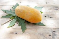 Ripe sweet papaya fruit and leaf. royalty free stock images