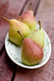 Ripe sweet pear lying on a plate Stock Photography