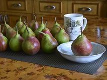 Ripe sweet pears  on a kitchen table. stock photo
