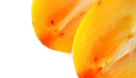 Ripe sweet persimmon isolated on white Stock Images
