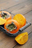 Ripe sweet persimmons Royalty Free Stock Photography