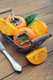 Ripe sweet persimmons Royalty Free Stock Images