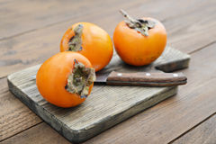 Ripe sweet persimmons Stock Images