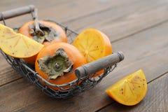 Ripe sweet persimmons Stock Photo