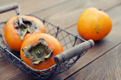 Ripe sweet persimmons Royalty Free Stock Photos
