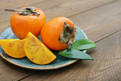 Ripe sweet persimmons Stock Photography