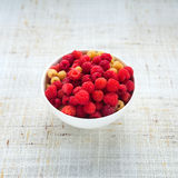 Ripe sweet raspberries in bowl Royalty Free Stock Images