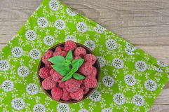 Ripe sweet raspberries in bowl on table close-up.  Stock Photography