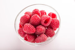Ripe sweet raspberries in bowl on white Royalty Free Stock Images
