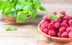Ripe sweet raspberries in bowl on wooden table, closeup. Selective focus Royalty Free Stock Photo