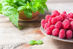 Ripe sweet raspberries in bowl on wooden table, closeup. Selective focus Stock Photography