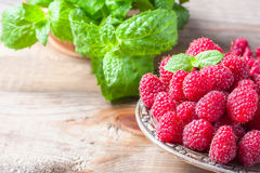 Ripe sweet raspberries in bowl on wooden table, closeup. Selective focus Royalty Free Stock Photos