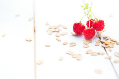 Ripe sweet raspberries with muesli on wood table background Royalty Free Stock Images