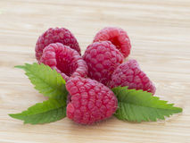 Ripe sweet raspberries on wooden table Stock Photography
