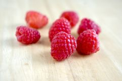 Ripe sweet raspberries on wooden table,. Very delicious product Royalty Free Stock Photography
