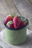 Ripe sweet strawberries in pot Royalty Free Stock Photography
