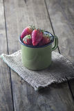 Ripe sweet strawberries in pot Royalty Free Stock Photo