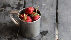 Ripe sweet strawberry in the metal mug. stock footage
