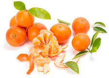 Ripe sweet tangerine with leaves and slices Stock Photos