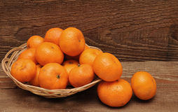 Ripe tangerine fruits in basket Stock Images