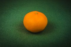 ripe tangerine on a green background, Christmas background, Christmas, new year Stock Photography