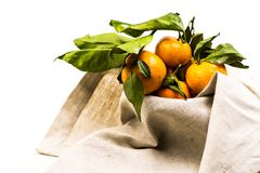 Ripe pile of tangerines on the linen table cloth Royalty Free Stock Photo