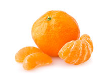 Ripe tangerine with slices Royalty Free Stock Photo