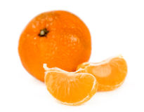 Ripe tangerine with slices close-up Royalty Free Stock Photography