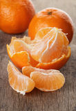 Ripe tangerines closeup photo on wooden table Stock Photos