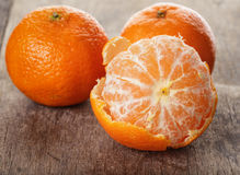 Ripe tangerines closeup photo on wooden table Royalty Free Stock Photography